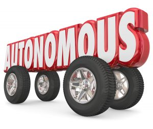 Autonomous 3d red word with wheels or tires to illustrate a self