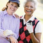 Portrait Of Two Female Golfers